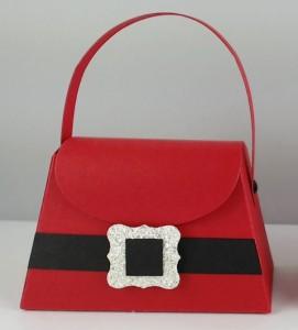 mini-tasche im weihnachtsmannkostüm